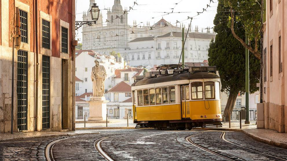 Traditional yellow tramway in Lisbon.